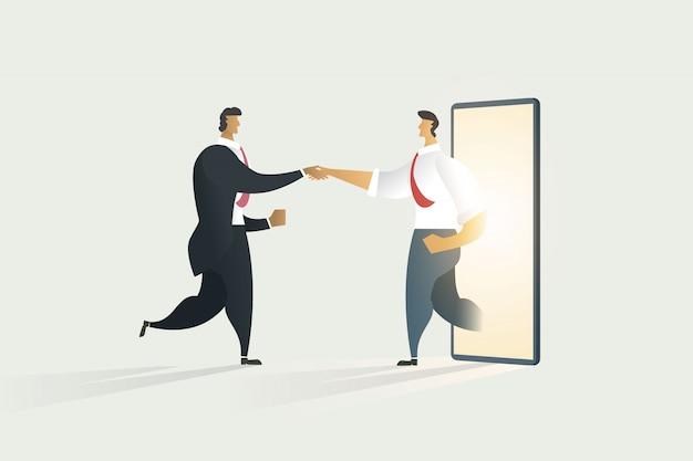 Mensen uit het bedrijfsleven handen schudden door middel van samenwerking op mobiele display. Premium Vector