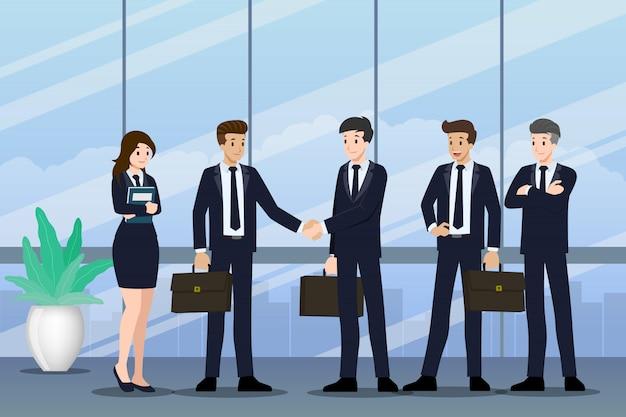 Mensen uit het bedrijfsleven staan en schudden elkaar de hand. Premium Vector