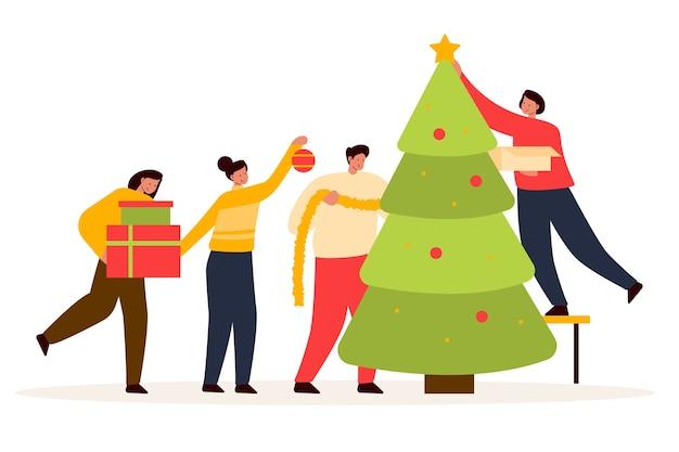Mensen versieren kerstboom samen Gratis Vector