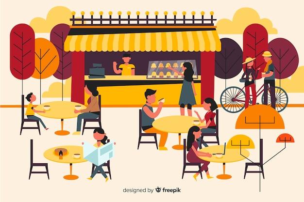 Mensen zitten in cafe herfst seizoen Gratis Vector
