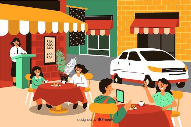 Mensen zitten in een café Gratis Vector