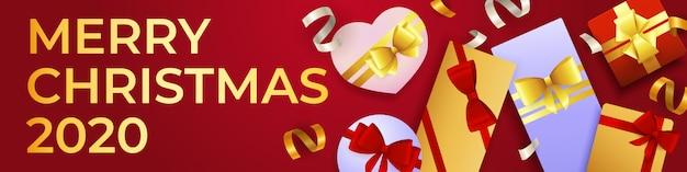 Merry christmas banner met overvloed van geschenkdozen Gratis Vector