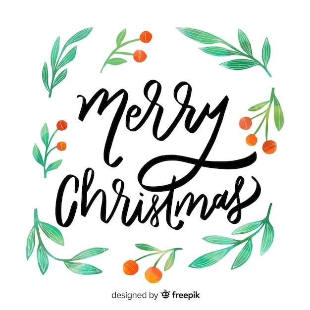 Merry christmas belettering met maretak Gratis Vector