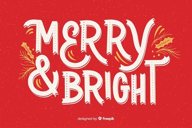 Merry christmas belettering op rode achtergrond Gratis Vector