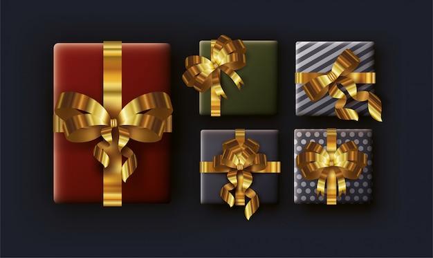 Merry christmas card met geschenken en gouden linten Premium Vector