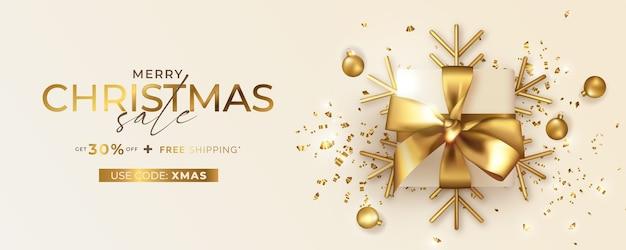 Merry christmas sale-banner met couponcode en realistische gouden geschenk Gratis Vector