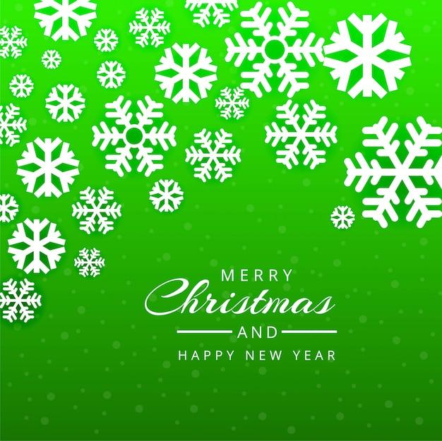Merry christmas wenskaart groene sneeuwvlokken achtergrond Gratis Vector