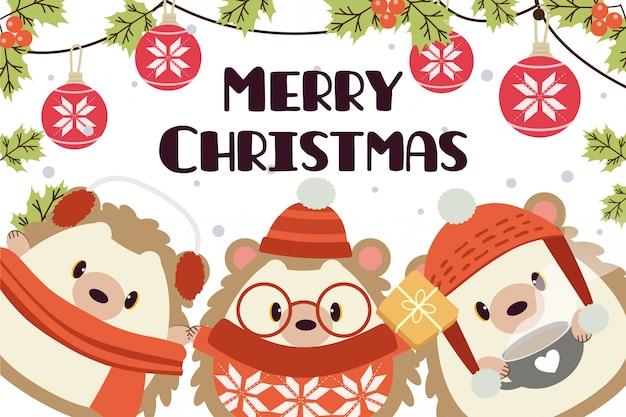 Merry christmas wenskaart met karakters van schattige egel Premium Vector