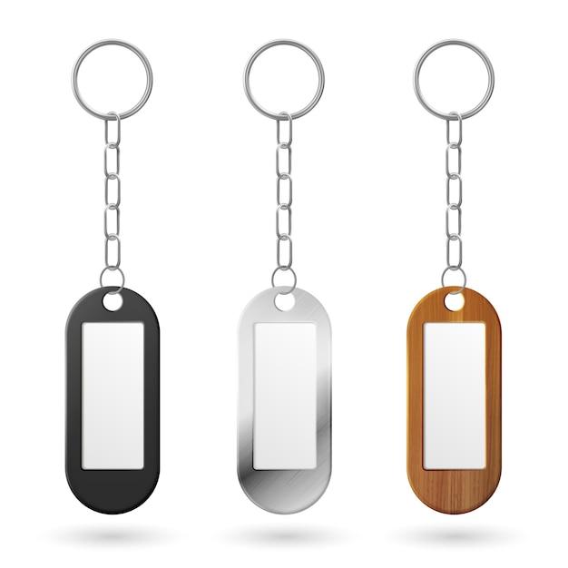 Metalen, plastic en houten sleutelhangers Gratis Vector