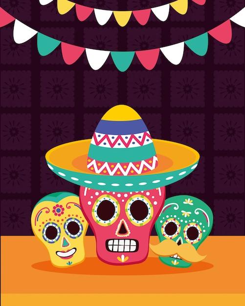 Mexicaanse schedels met hoed en slingers Gratis Vector