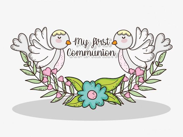 Mijn eerste communie met duiven en bloemen met bladeren Premium Vector