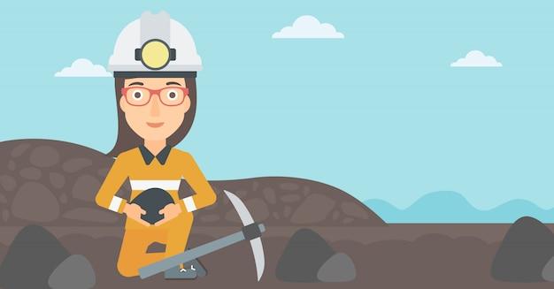 Mijnwerker die steenkool in handen houdt. Premium Vector