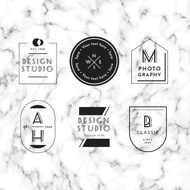 Minimale logo-collectie op marmeren achtergrond Gratis Vector