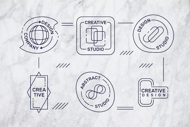 Minimale logo's op marmeren achtergrond Gratis Vector