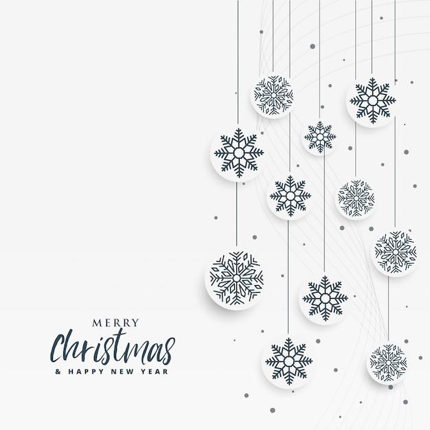 Minimale witte kerstmisachtergrond met sneeuwvlokken Gratis Vector