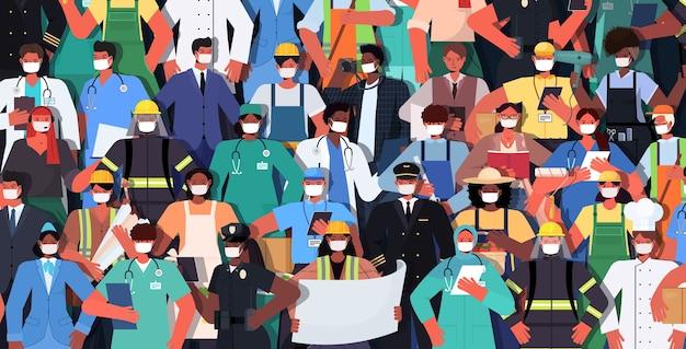 Mix race mensen van verschillende beroepen samen staan dag van de arbeid viering concept mannen vrouwen maskers dragen om coronavirus horizontale vector illustratie te voorkomen Premium Vector