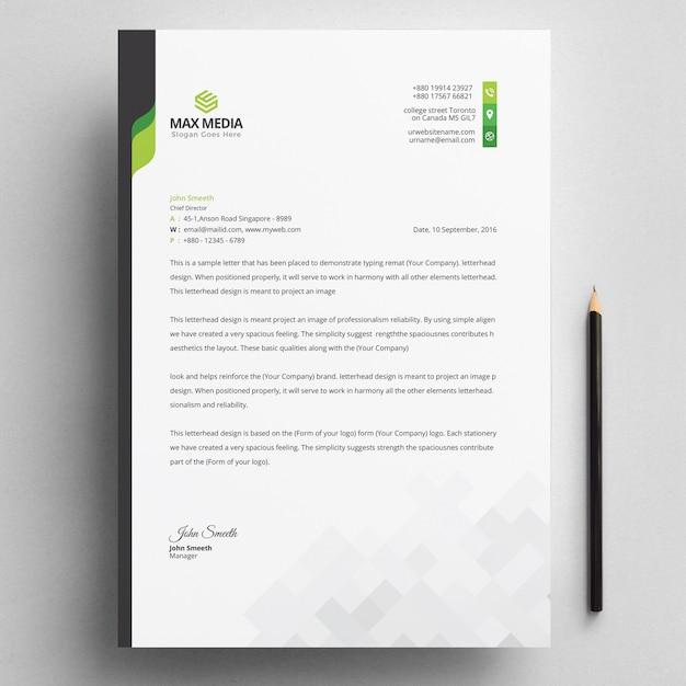 Modern bedrijfsbriefpapier met groene elementen Premium Vector