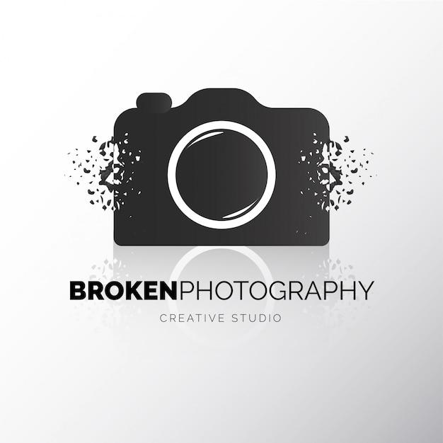 Modern camera gebroken logo Gratis Vector