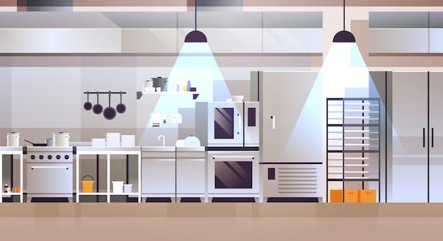 Modern interieur van professionele café of restaurant keuken met keukengerei en apparatuur koken Premium Vector