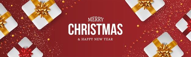 Moderne merry christmas banner achtergrond met realistische kerstcadeaus samenstelling Gratis Vector
