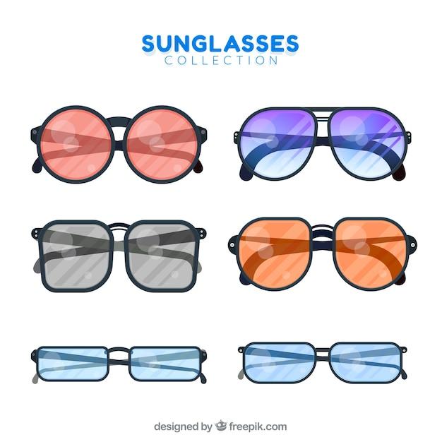Moderne zonnebrilcollectie in vlakke stijl Gratis Vector