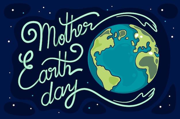 Moeder aarde dag belettering en planeet Gratis Vector