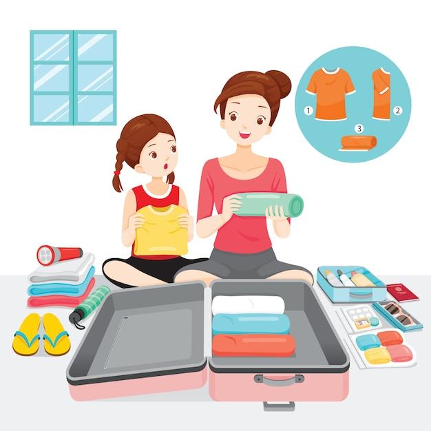 Moeder die haar dochter leert om kleren en benodigdheden op bagage voor reis voor te bereiden Premium Vector