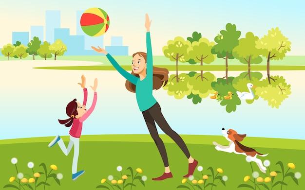 Moeder en dochter met een hond spelen bal op het meer in het park Premium Vector