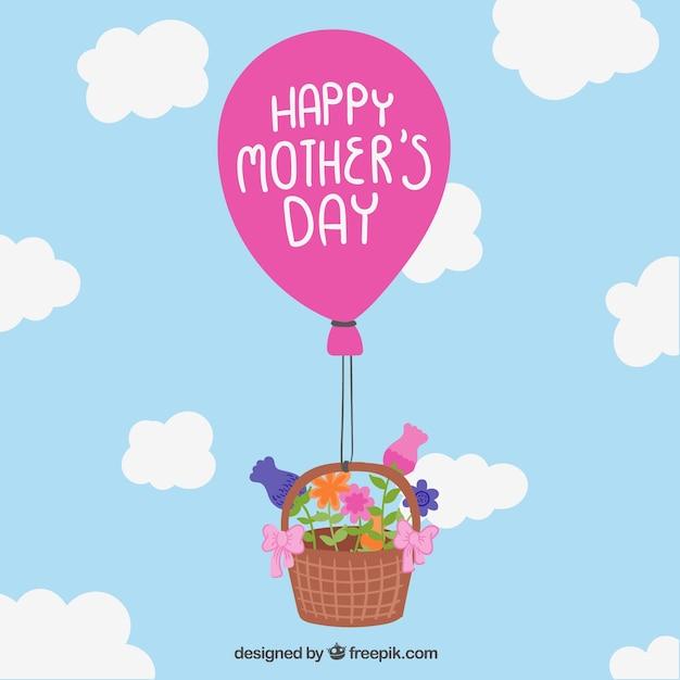 Moeders dag kaart met mand en ballon Gratis Vector