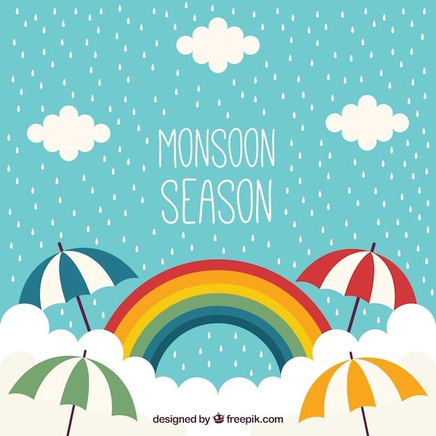 Monsoon achtergrond met regenboog Gratis Vector