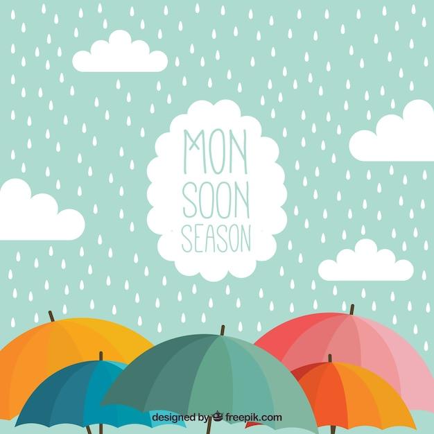 Monsoon achtergrond met umbrela Gratis Vector