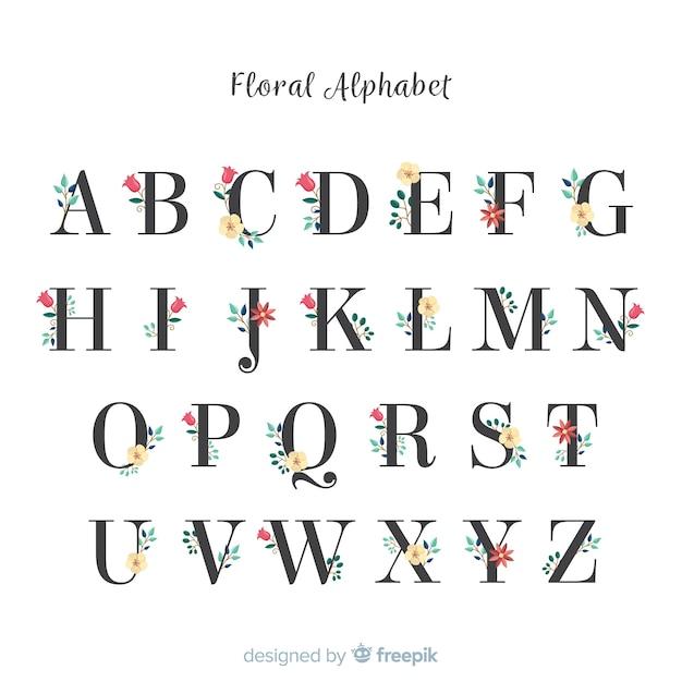 Mooi alfabet met bloemen Gratis Vector
