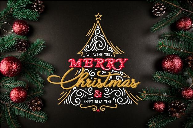 Mooi kerstmisconcept met het van letters voorzien Gratis Vector