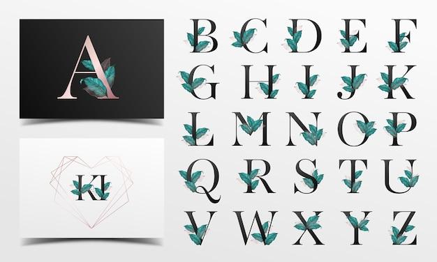 Mooie alfabetcollectie met bladwaterverfdecoratie Gratis Vector
