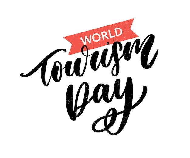 Mooie belettering voor toeristische dag. wereldtoerismedag. Premium Vector