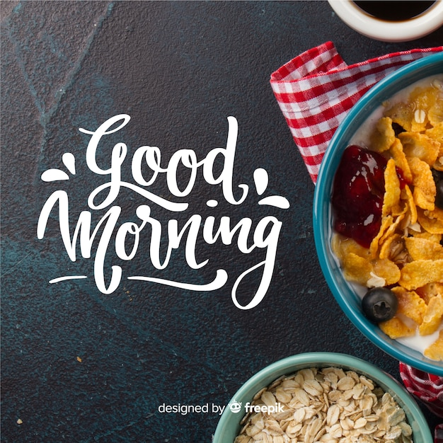 Mooie goedemorgen belettering achtergrond Gratis Vector