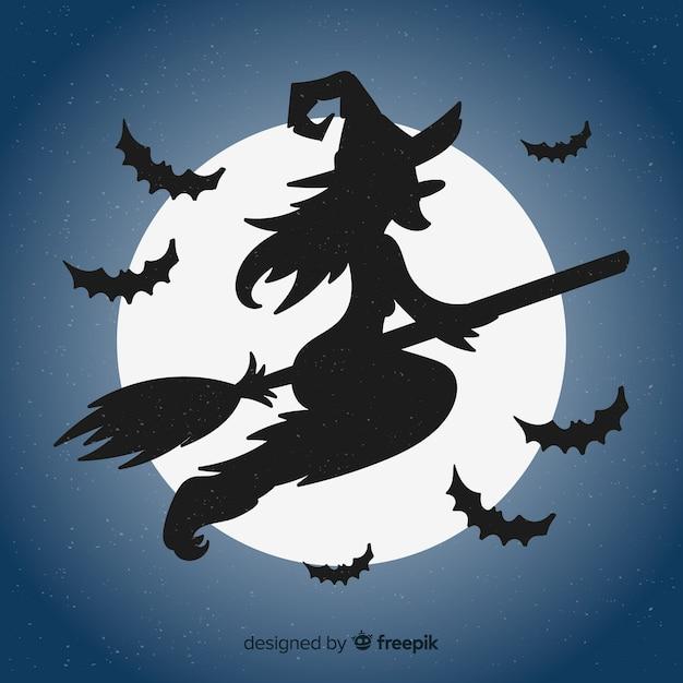 Mooie halloween-heksenachtergrond Gratis Vector