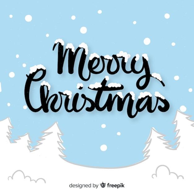 Mooie hand getekend kerst belettering Gratis Vector