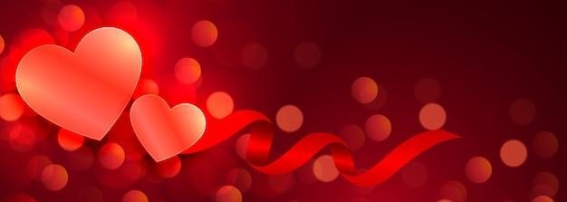 Mooie harten gloeiende rode bokehbanner Gratis Vector