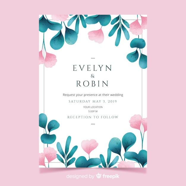 Mooie huwelijksuitnodiging met waterverfbladeren en bloemen Gratis Vector