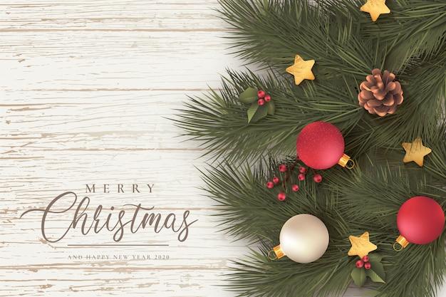 Mooie kerst achtergrond met bladeren en ornamenten Gratis Vector