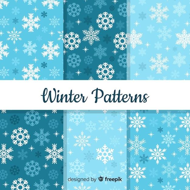 Mooie reeks kleurrijke de winterpatronen Gratis Vector