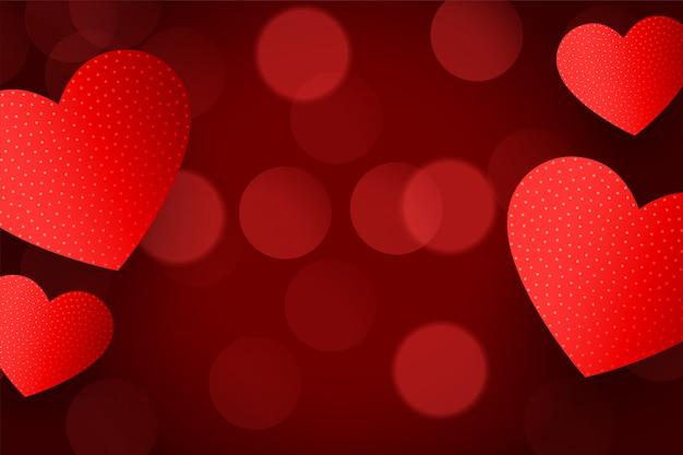Mooie rode hartenachtergrond met bokeheffect Gratis Vector