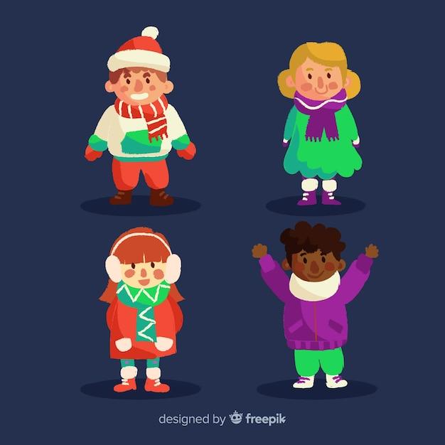 Mooie set gelukkige kinderen met winterkleren Gratis Vector