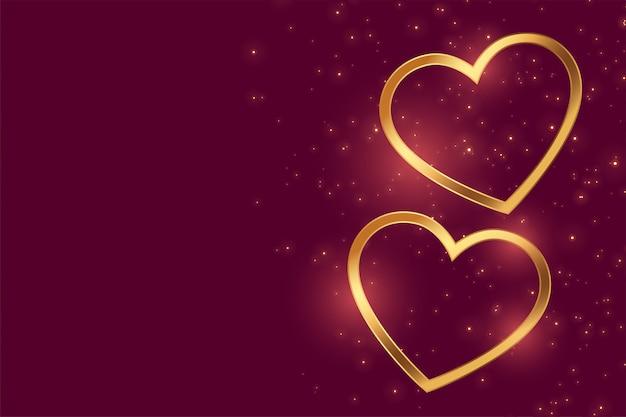 Mooie twee gouden liefdeharten met tekstruimte Gratis Vector