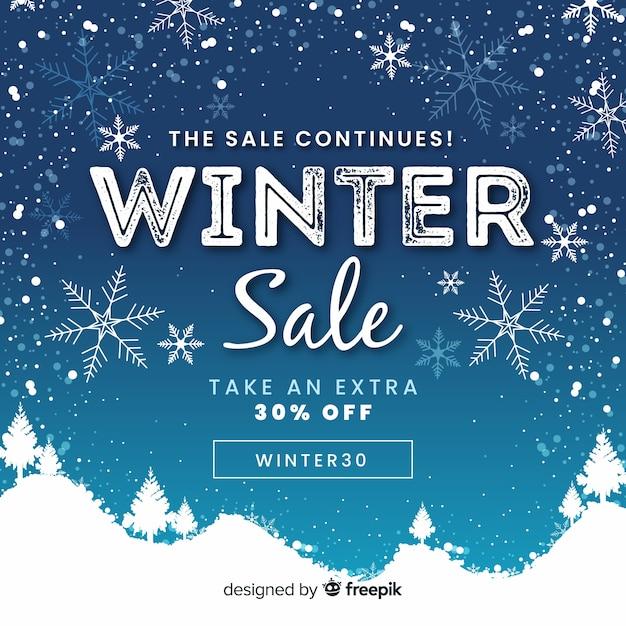 Mooie winter verkoop achtergrond Gratis Vector
