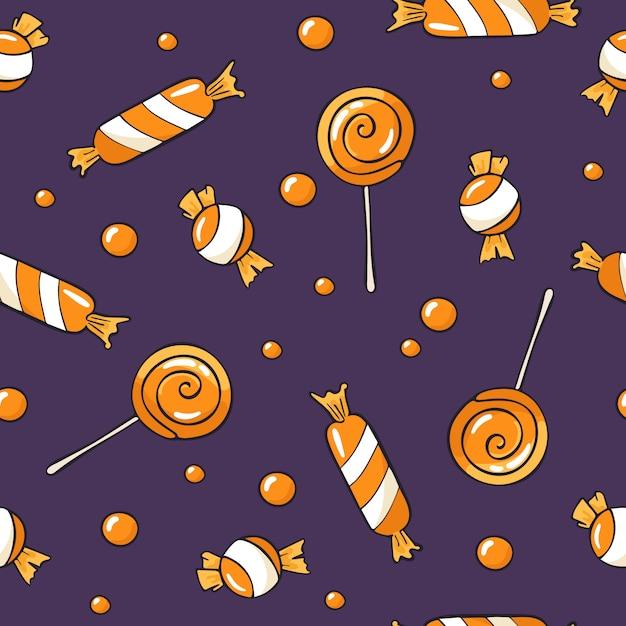 Naadloos halloween-patroon met snoepjes Premium Vector