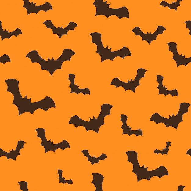 Naadloos halloween-patroon met vliegende knuppels Premium Vector