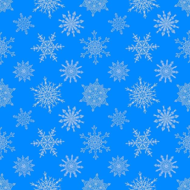 Naadloos kerstmis blauw patroon met getrokken sneeuwvlokken Premium Vector