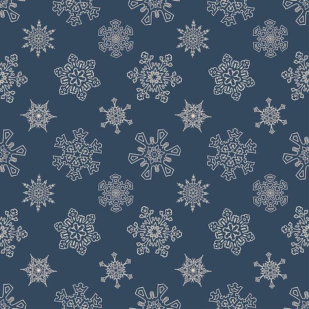 Naadloos kerstpatroon met getrokken sneeuwvlokken Premium Vector